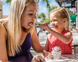 child feeding woman ice cream